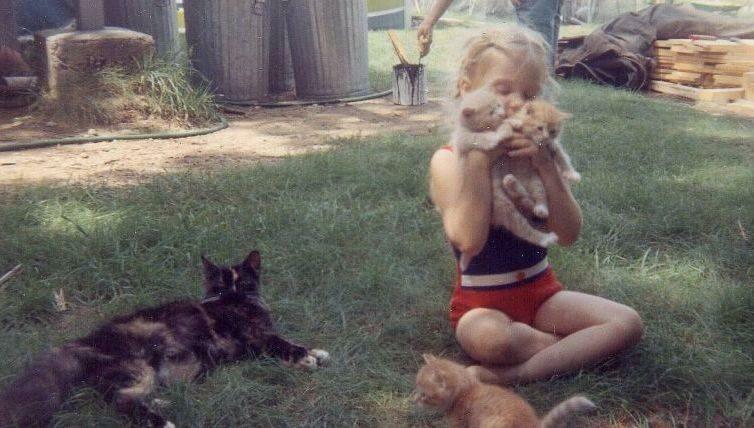 Little girl holding kittens